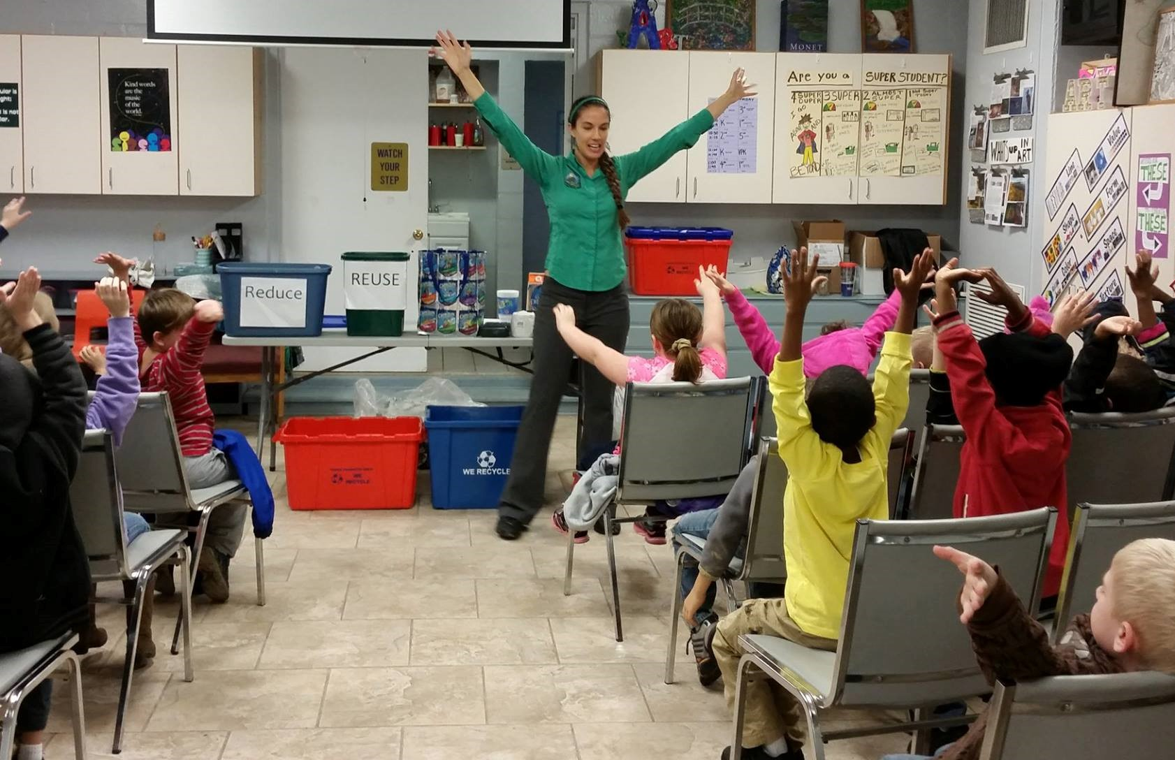 Alachua County employee giving a recycling presenttion to local schoolchildren