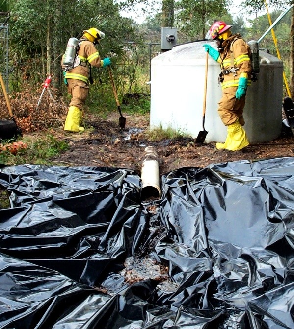Firefighters cleaning up a spill